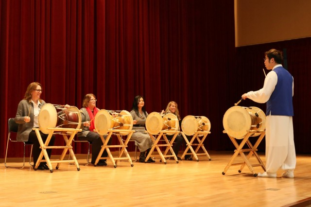 Mrs. Leah Esper, spouse of Secretary of the Army Mark T. Esper, learns how to play the traditional Korean drum known as the Jung-gu, during her visit to the Republic of Korea, Jan. 9, 2018.
