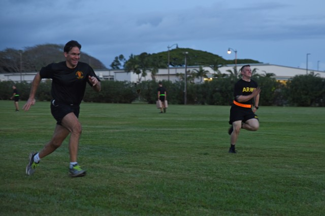 Secretary of the Army Mark Esper flips a tire during physical readiness training on January 11, with 3rd Infantry Brigade Combat Team, 25th Infantry Division at Schofield Barracks, Hawaii. Esper visited 25th ID and other Army units in Oahu for the first time since being appointed as the Secretary of the Army