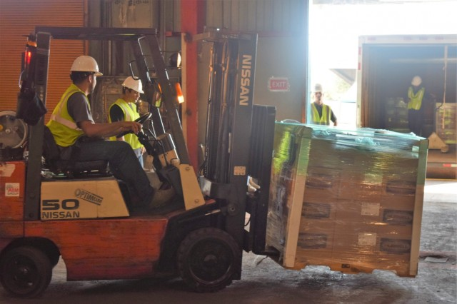 PONCE, PUERTO RICO - Tons of critical power grid materials arrive daily for temporary housing at the Ponce warehouse, part of the critical electrical components needed to rebuild the island's power grid. The U.S. Army Corps of Engineers' Task Force Power Restoration team maintains 100 percent accountability of every item, from the smallest electrical component to the 5,500-pound concrete utility pole, until it arrives at the delivery site, is stored and ultimately issued to the workforce.