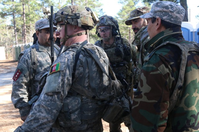 A soldier assigned to 2nd Battalion, 1st Security Force Assistance Brigade, center, advises his partners on the capture of a simulated high-value target with simulated Afghan National Defense Security Forces during a Joint Readiness Training Center rotation, Jan. 13, 2018, at Fort Polk, La. SFABs are a permanent, additive force structure. They are being developed and deployed as a solution to an enduring Army requirement in support of the defense strategy. (U.S. Army photo by Sgt. Arjenis Nunez/Released)