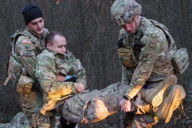 Yavoriv, Ukraine - Spc. Caleb Bailey and Spc. Robert Graber, two combat medic assigned to the Joint Multinational Training Group - Ukraine (JMTG-U) participates in a MASCAL exercise here Jan. 12. The exercise, which was designed to resemble a vehicle collision, was used to test the JMTG-U Medical Section's readiness and capabilities. During the exercise the medics that responded had to triage and treat simulated casualties before transporting them to the Troop Medical Clinic for further care. (U.S. Army photo by Sgt. Alexander Rector)