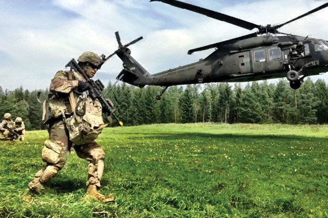 "Infantrymen with 3rd Armored Brigade Combat Team (""Iron Brigade""), 4th Infantry Division, conduct an air assault in August with 3rd General Support Aviation Battalion, 10th Combat Aviation Brigade during the U.S. Army Europe Combined Resolve IX exercise at Grafenwoehr Training Area, Germany. Army S&T is pursuing aircraft survivability technologies across a spectrum of technologies and areas of expertise."