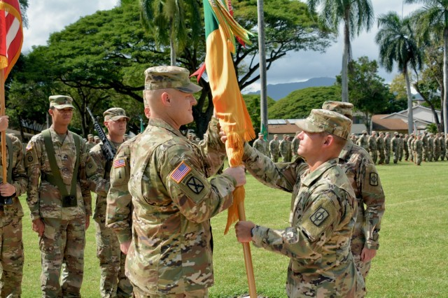 Col. Shannon-Mikel Lucas passes the 8th Military Police Brigade Colors to the incoming brigade senior enlisted advisor, Command Sgt. Maj. William Mayfield, during a Change of Responsibility ceremony January 9 on Schofield Barracks' Hamilton Field. (U.S. Army Photo by Sgt. 1st Class John Brown, 8th Military Police Brigade Chief of Public Affairs)