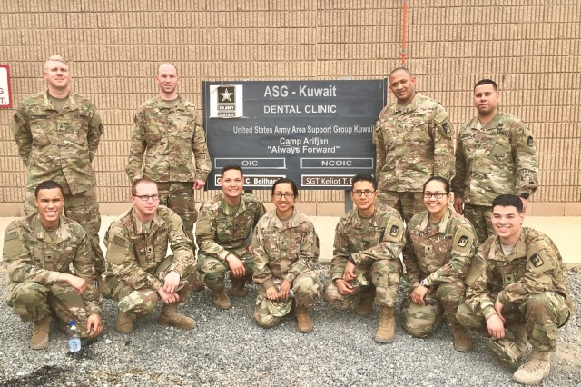 Soldiers of the 673 Dental Company Area Support pose for a photo at Camp Arifjan, Kuwait. The team of 11 Soldiers returned to JBLM Jan 12. (Army photo)