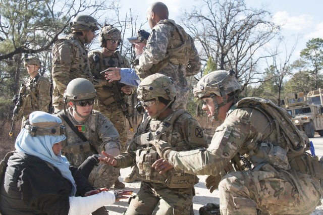 Combat medics assigned to 1st Battalion, 1st Security Forces Assistance Brigade advise an acting Afghan National Defense Security Forces medic on how to provide first-aid to an injured person during a Joint Readiness Training Center rotation, Jan. 15, 2018, at Fort Polk, La. The 1st Security Force Assistance Brigade allows the Army to reduce demand on conventional Brigade Combat Teams over time for combat advising, increasing their readiness for current and emerging near-peer threats. (U.S. Army photo by Sgt. Arjenis Nunez/Released)