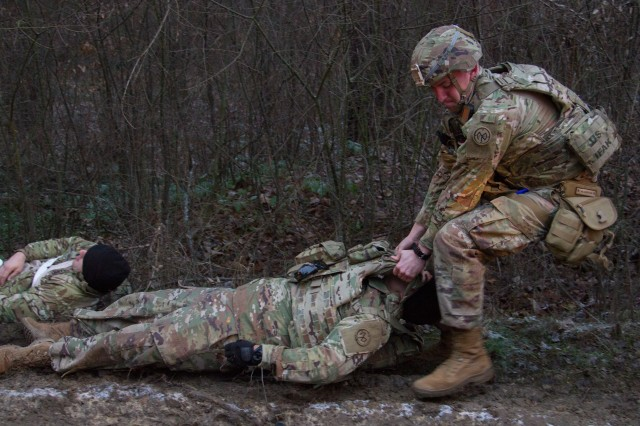 Spc. Caleb Bailey, a combat medic assigned to the Joint Multinational Training Group -- Ukraine (JMTG-U) treats a casualty during a MASCAL exercise here Jan. 12. The exercise, which was designed to resemble a vehicle collision, was used to test the JMTG-U Medical Section's readiness and capabilities. During the exercise the medics that responded had to triage and treat simulated casualties before transporting them to the Troop Medical Clinic for further care.