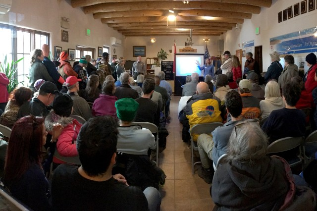 ABIQUIU LAKE, N.M. -- Volunteers for the annual Midwinter Eagle Watch listen to an introductory presentation from The Wildlife Center, Jan. 6, 2018, before heading out to the lake to count eagles.