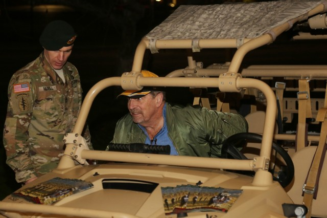 A 1st Special Forces Group (Airborne) Green Beret explains the maneuverability of a modified all-terrain vehicle, Jan. 13, to patrons coming to see the special showing of the movie 12 Strong: The Declassified True Story of the Horse Soldiers at Carey Theater, Joint Base Lewis-McChord, Wa. This movie is based on the unclassified story of 5th Special Forces Group (Airborne) mission in Afghanistan in response to the 9/11 terrorist attacks. The movie is focused on one of three teams involved in the operation and their Afghan partners, the Northern Alliance, in their mission to eliminate terrorist networks and destroy the Taliban safe havens in Afghanistan. (U.S. Army Photo by Staff Sgt. Marcus Butler, 1st Special Forces Group (Airborne) Public Affairs)