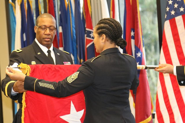 Newly promoted Brig. Gen. James S. Moore and Command Sgt. Maj. Pamela K. Williams inspect the general officer flag during a promotion ceremony Jan. 17, 2018, at American Lake Conference Center, Joint Base Lewis-McChord, Wash.