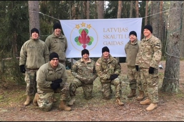 CAT 0736 and the 1ACB medical team pose for a group photo at Lozmetejkalns Scout Camp near Valgundes, Latvia. (U.S. Army photo by Spc. DeMarco Wills, 1st Air Cavalry Brigade. PAO (Released).
