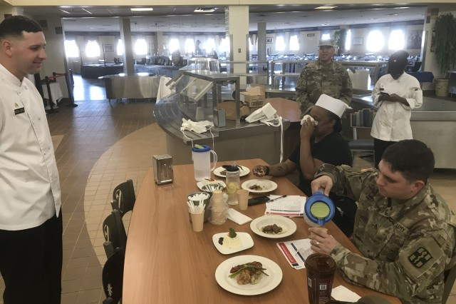 Sgt. Jonathan Rivera-Lopez stands before a judge during the Hot Food portion of the III Corps 1st Quarter NCO Chef of the Quarter competition Jan. 9, 2018, at Fort Hood, Texas. Rivera-Lopez took first place in the competition.