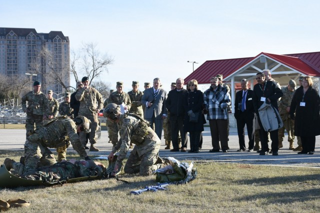 Community partners representing the nation's leading medical organizations and prominent universities watch a full-scaled demonstration of a battlefield air medical evacuation on MacArthur Parade Field Jan. 4 at Joint Base San Antonio-Fort Sam Houston, Texas.