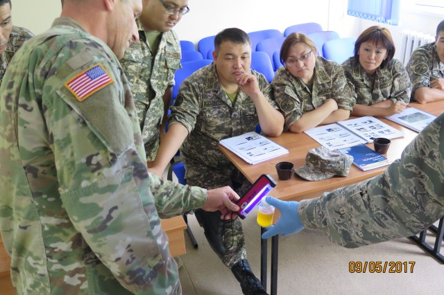 "Kazak Soldiers learn to field test water samples for contamination during a Subject Matter Expert Exchange on ""Operational Preventive Medicine in Support of Deploying Forces""."