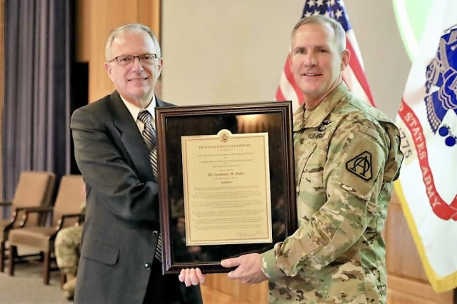 "Brig. Gen.  Anthony ""Tony"" Potts receives his Program Executive Officer Charter from the Honorable Bruce Jette, Army Acquisition Executive. General Potts became PEO Soldier during a Change-of-Charter ceremony Jan. 16. (U.S. Army photo by Ron Lee)"
