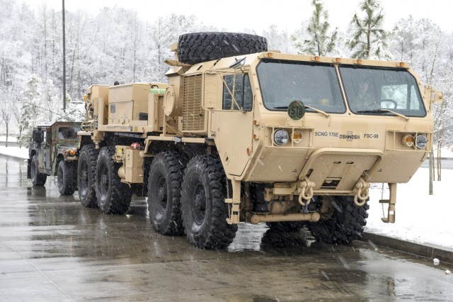 U.S. Soldiers with the Field Maintenance Shop 5 Vehicle Recovery Team, South Carolina National Guard, help assist Highway Patrol with vehicle recovery during a snow storm in Rock Hill, South Carolina, Jan. 17, 2018. The Soldiers were on standby for any calls received by the Highway Patrol of vehicles that become stuck, abandoned, or block access to the roadways.