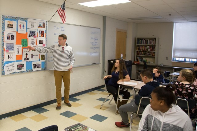 Gregory Kessler, an English language arts teacher at Horace Mann Middle School in Franklin, Mass., teaches a class on using keywords when developing an essay Jan. 12, 2018. Kessler has been teaching for the past five years while simultaneously serving as a Public Affairs Officer in the 65th Press Camp Headquarters of the Massachusetts Army National Guard.