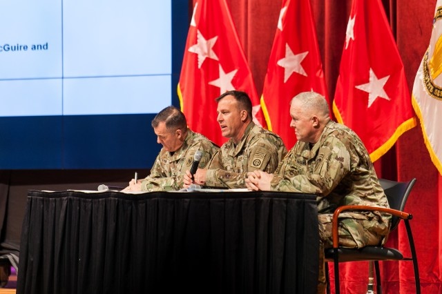 A panel discussion takes place on current operations and their implications for the maneuver force during the first full day of the Maneuver Warfighter Conference at Fort Benning, Georgia, Jan. 9. Panelists during the event included Maj. Gen. Charles A. Flynn, deputy commanding general of U.S. Army Pacific; Maj. Gen. Michael E. Kurilla, commanding general of 82nd Airborne Division; Maj. Gen. Timothy P. McGuire, deputy commanding general of U.S. Army Europe; and Brig. Gen. Christopher T. Donahue, commandant of U.S. Infantry School. (Photos by: Suhyoon Wood/MCoE PAO Photographer)