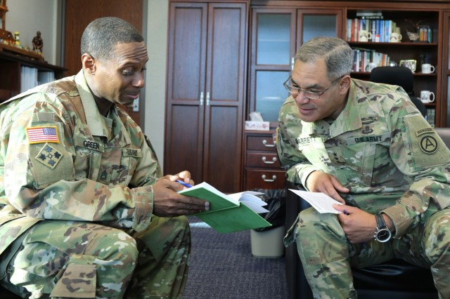 Army Medicine Ambassador Sgt. 1st Class Sean A. Green (left) checks his notes with Lt. Gen. Michael X. Garrett, Commander of U.S. Army Central (USARCENT).  Garrett discussed fitness, readiness, and 100 Days of Strength with Green.  Physical fitness and medical readiness are taught at USARCENT as critical priorities necessary for warfighters to accomplish their individual and organizational missions—no matter where duty takes them.  A Soldier's level of physical fitness impacts overall health, job performance, and morale within organizations.  At USARCENT, fitness is necessary and falls squarely within the Army and Army Medicine's readiness and health priority.  Green is an Army Medicine Ambassador, sharing news about Army Medicine and the service they provide to our Soldiers, their families and the communities they live in and serve.