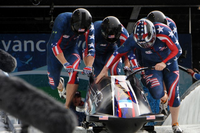 "Former U.S. Army World Class Athlete Program bobsledder Steven Holcomb (front right) leads ""The Night Train"" team of Sgt. Justin Olsen, Steve Mesler and Curtis Tomasevicz to a start time of 4.77 seconds in the third heat of the Olympic four-man bobsled event. The quartet won an Olympic gold medal in bobsleigh for Team USA for the first time in 62 years at the Whistler Sliding Centre on Saturday."