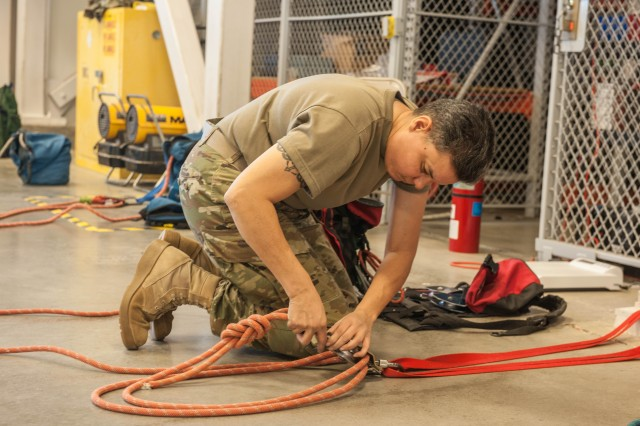 Master Sgt. Edith Horn puts together a pulley system during a test on mechanical advantages at the end of the first week of the USACBRNS' Technical Escort Course.