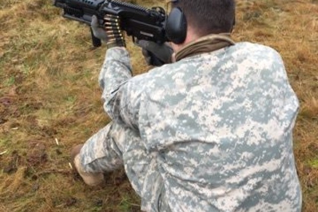 Army Staff Sgt. Matthew Severino, from the Provost Marshal Office at U.S. Army Garrison Benelux in Brussels, tests the capabilities of the FN 7.62mm MINIMI from the kneeling position. Soldiers, participated in a weapons training with the Belgian Army from Jan. 8 to 12, 2018, in Arlon, Belgium.