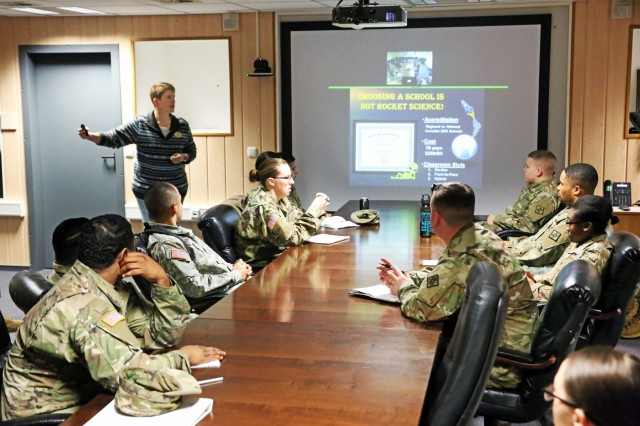 Cris Weisbecker, Education Services Officer at the Wiesbaden Education Center, gives a presentation to U.S. Army Signal Soldiers about higher education opportunities and Army services during the 102nd Strategic Signal Battalion, 2nd Theater Signal Brigade, quarterly Soldier Development Program Jan. 18, 2018 in Wiesbaden, Germany. The Soldier Development Program provides Soldiers with information on a wide variety of personal and professional topics, including higher education, designed to grow junior Soldiers into future leaders. (U.S. Army photo by William B. King)