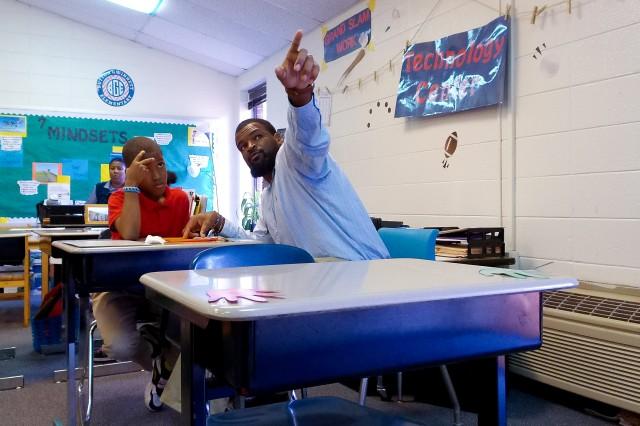 Winn ACH Ambassador, Calvin Glover, works as a Patient Advocate at Winn ACH and serves as a MindShift mentor, spends time with his mentee during class at Button Gwinnett Elementary School.