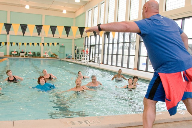 Ryan Clark, aquatics branch assistant manager, leads participants through a series of dance moves designed to increase heart rate and tone muscles.