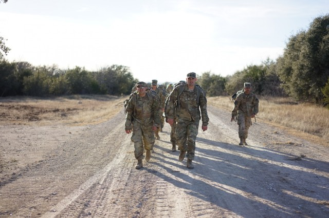 Spur candidates from all teams are required to complete a 22 mile ruck-march in order to earn their spurs at the 2nd Battalion, 82nd Field Artillery Regiment, 3rd Armored Brigade Combat Team, 1st Calvary Division, spur ride Jan. 9.(U.S. Army courtesy photo by 1st Lt. Andrew Carstensen)
