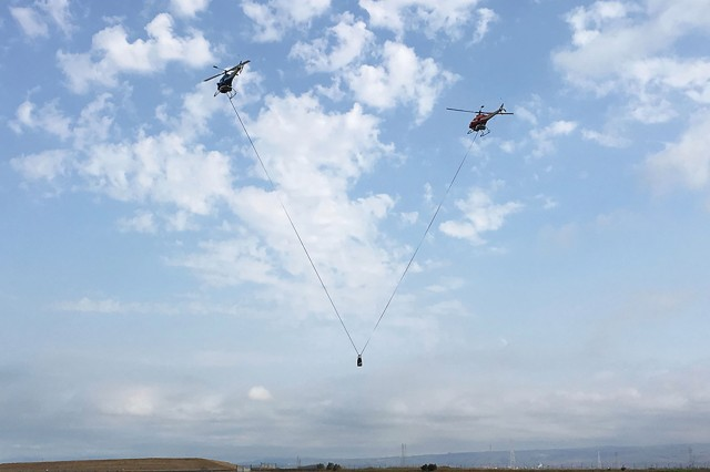 AMRDEC's Aviation Development Directorate (ADD) conducts autonomous dual-lift operations with two RMAX UAS carrying a 20-pound payload through a set of hover and low-speed maneuvers at Moffett Federal Airfield, California, in September. The helicopters are an autonomous flight resource developed by ADD and have been used for numerous flight experiments since 2002.