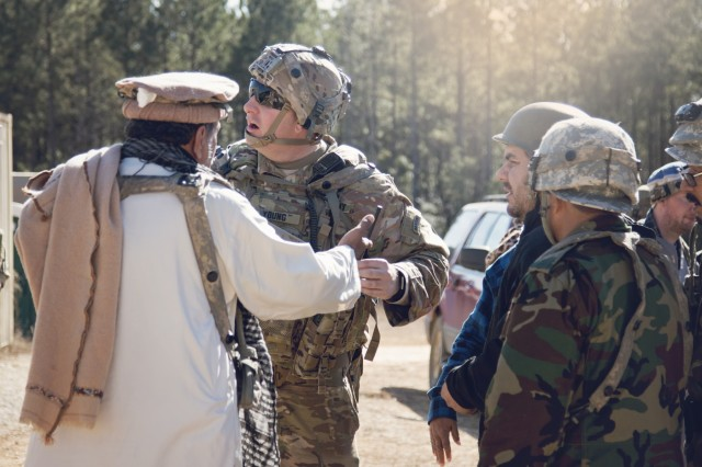 Capt. Christopher Young, a combat advisor team leader assigned to the 1st Security Force Assistance Brigade speaks with simulated Afghan locals during rotation 18-03 at the Joint Readiness Training Center, Jan. 15, 2017.