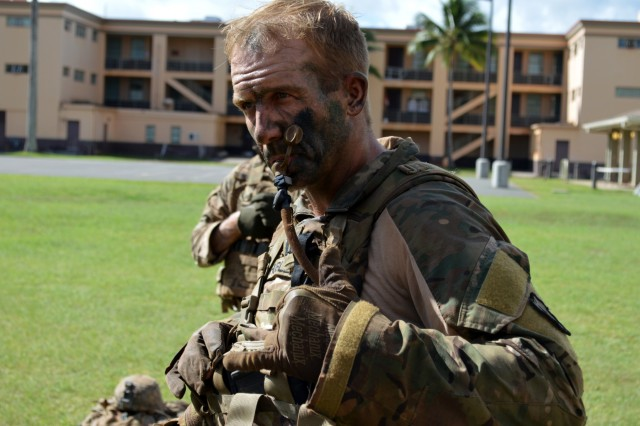 Capt. Jeffrey Hubler, commander, Company A, 2nd Battalion, 35th Infantry Regiment, 3rd Brigade Combat Team, 25th Infantry Division, takes a water break after completing the final road march event for Mungadai at Schofield Barracks, Hawaii, Jan. 11, 2018. The purpose of Mungadai is to create, trained, and ready professionals, prepared with operational and foundational knowledge, to take disciplined initiative while implementing and executing their commander's intent. (U.S. Army photo by Staff Sgt. Armando R. Limon, 3rd Brigade Combat Team, 25th Infantry Division)