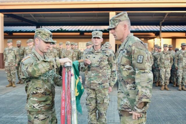 Capt. Edgar Conrad and 1st Sgt. James Rutherford, 58th Military Police Company, 728th Military Police Battalion, 8th Military Police Brigade, uncase the unit guidon at Schofield Barracks, Hawaii, following a six-month deployment to Anderson Air Force Base, Guam on January 10, 2018. (U.S. Army Photo by Sgt. 1st Class John Brown, 8th Military Police Brigade Chief of Public Affairs)