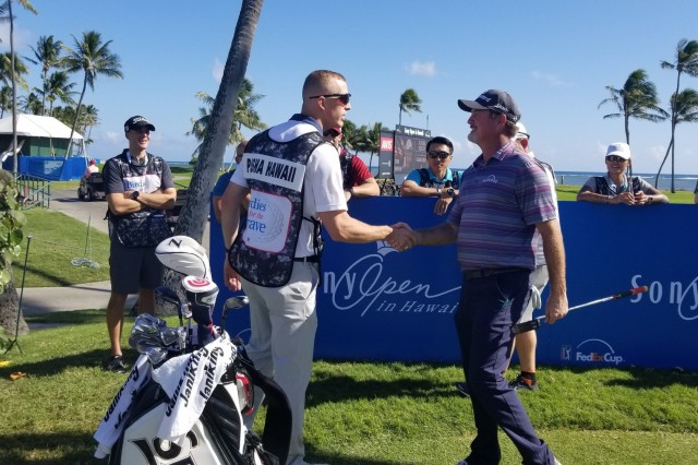Pro Golfer Jerry Kelly, shakes hands with his Birdies for the Brave caddie for the 18th hole at the Sony Open, Hawaii.  Birdies for the Brave is a national military outreach initiative dedicated to honoring and showing appreciation to the courageous men and women of the United States Armed Forces and their families. (U.S. Army Photo by Staff Sgt. John Portela)