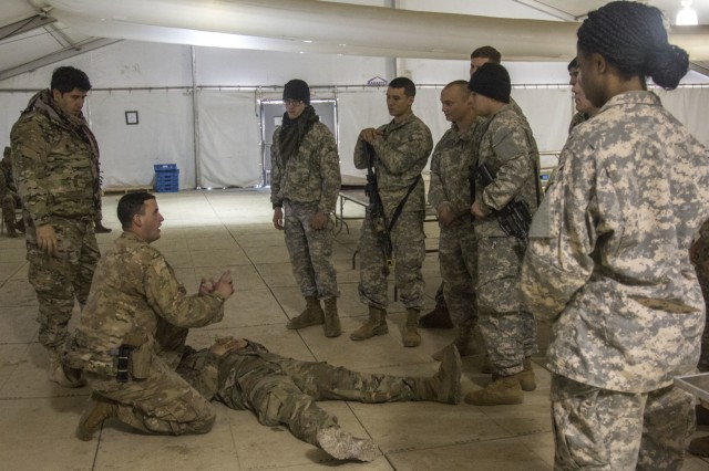 Soldiers assigned to the 3rd Battalion, 1st Security Force Assistance Brigade, train role players serving as Afghan National Army soldiers on basic combat medical tactics during their Joint Readiness Training Center rotation at Fort Polk, La., Jan 18, 2018. The SFABs provide better combat advising capabilities while enabling brigade combat teams to prepare for decisive action, improving readiness of the Army and its partners in the long term. (U.S. Army photo by Spc. Noelle E. Wiehe, 50th Public Affairs Detachment, 3rd Infantry Division/ Released)