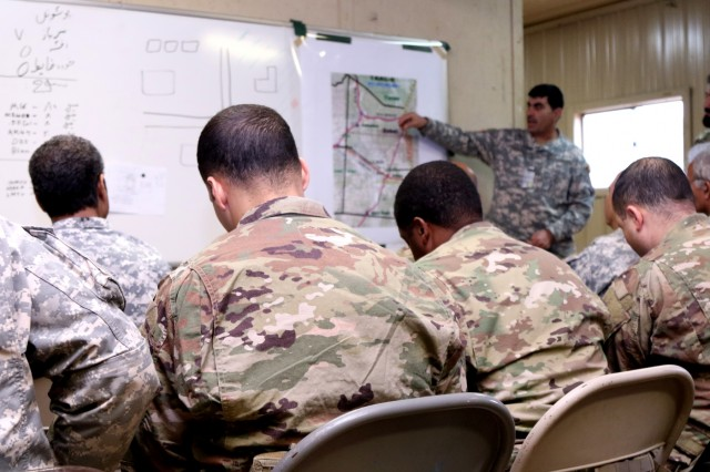 Soldiers from the 4th Battalion, 1st Security Force Assistance Brigade logistic advisor team take notes during a logistics brief given by a role player acting as the Afghan National Army kandak [battalion] commander during the logistics exercise conducted at Fort Polk, La., as part of their Joint Readiness Training Center rotation on Jan. 19, 2018. The logistics exercise has the 1st SFAB LATs working alongside the ANA to train, advise, assist, accompany and enable them to logistically support a mission that is handed down from ANA Corps. (U.S. Army photo by Sgt. Joseph Truckley, 50th Public Affairs Detachment, 3rd Infantry Division/Released)