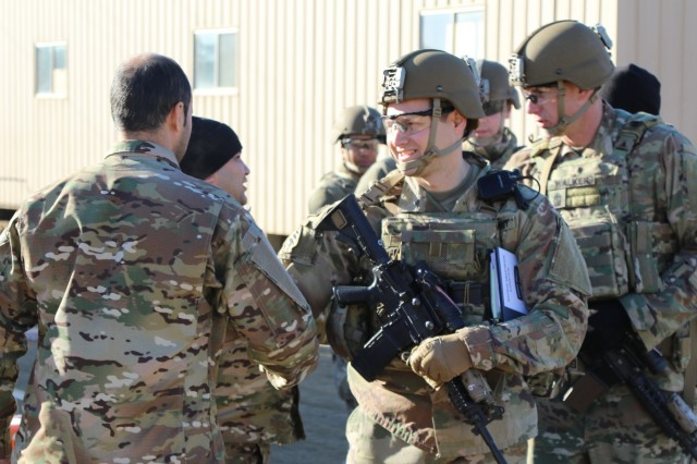 Maj. Michael Pachucki and his 2nd Battalion, 1st Security Force Assistance Brigade Logistic Advisor Team from Ft. Benning, Georgia shakes the hand of a role player acting as a member of the Afghan National Army at Fort Polk, La., as part of the logistic exercise during their Joint Readiness Training Center rotation Jan. 18, 2018. The logistic exercise has the 1st SFAB LATs working alongside the ANA to train, advise, assist, accompany and enable them to logistically support a mission that is handed down from ANA Corps. (U.S. Army photo by Sgt. Joseph Truckley, 50th Public Affairs Detachment, 3rd Infantry Division/Released)