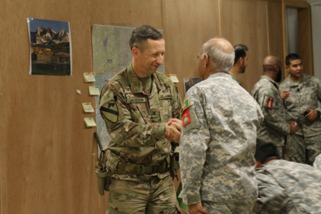 Col. Scott Jackson, 1st Security Force Assistance Brigade commander, greets a role player leader of the Afghan National Army prior to a briefing during a command post exercise held Jan. 15, 2018, during the first-ever, month-long 1st SFAB training rotation at the Joint Readiness Training Center in Fort Polk, La. The engagement was held to prepare the 1st SFAB leadership for roles they may encounter through their upcoming deployment to provide training and advising assistance to Afghan National Security Forces. (U.S. Army photo by Spc. Noelle E. Wiehe, 50th Public Affairs Detachment/ Released)