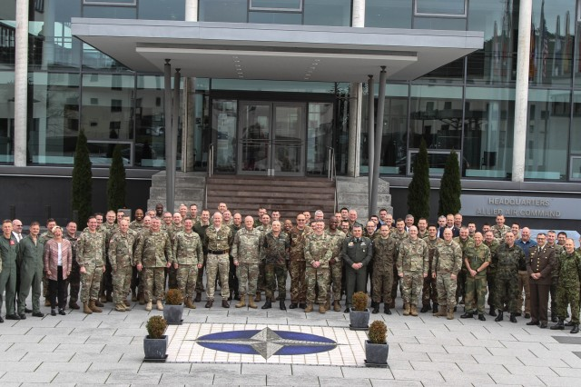 The International War Fighting Forum attendees, made up of leaders and over 20 general officers across several countries, pose outside the Allied Air Command Headquarters on Ramstein Air Base, Germany Jan. 11, 2017.