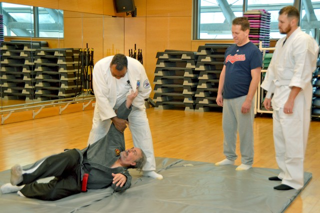 Participants practice newly learned martial arts techniques during the Evolution for Change Fitness Resolution Day.
