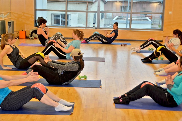 Community members enjoy a free fitness class during the Evolution for Change Fitness Resolution Day.