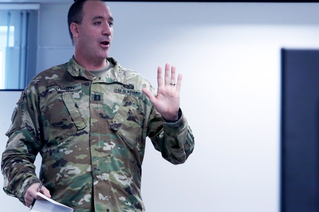 U.S. Army Capt. Casey O'Brien, an instructor for the Theater Sustainment Planners Course, which was taught by the Army Logistics University from Fort Lee, Va., for the first time in the Hohenfels Training Area, critiques students following the course, in Hohenfels, Germany, Jan. 19, 2018. The training was in preparation of future rotational exercises where the OC/T's will start evaluating leaders and their sustainment planning capabilities.