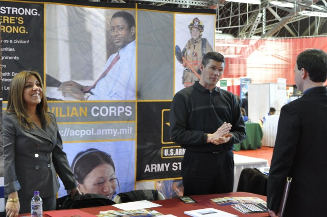 Watervliet Arsenal personnel specialists Jennifer Pusatere and James Ehman working a job fair at a local university.