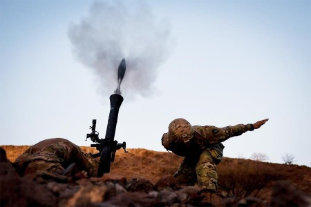 A mortarman attached to Combined Joint Task Force-Horn of Africa, releases a mortar during Alligator Dagger in Djibouti, Africa, Dec. 17, 2017.