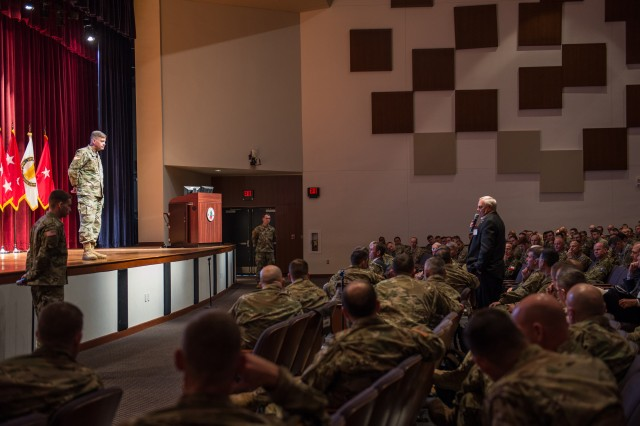 FORT BENNING, Ga. (Jan. 23, 2018) -- Gen. David G. Perkins, commander of the U.S. Army Training and Doctrine Command, takes questions from the audience following his talk on training transition at the Maneuver Warfighter Conference Jan. 11. The Maneuver Center of Excellence held the Maneuver Warfighter Conference at Fort Benning, Georgia, Jan. 8 through 11. The multi-day event included speaking portions by three four-star generals, a former speaker of the House of Representatives, a futurist, and many others, who focused on cross-domain maneuver and preparing for the future. (U.S. Army photo by Suhyoon Wood, Maneuver Center of Excellence, Fort Benning Public Affairs)