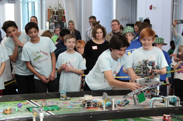 Team Super Technical Underground Design Society, or STUDS, gets excited with one of the challenges during the For Inspiration and Recognition of Science and Technology Lego League Qualifier held at the U.S. Army Test and Evaluation Command headquarters on Aberdeen Proving Ground North (Aberdeen) Jan. 20, 2018.