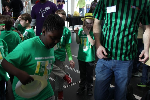 A student participant and head referee are caught dancing during the For Inspiration and Recognition of Science and Technology Lego League Qualifier held at ATEC headquarters on Aberdeen Proving Ground North (Aberdeen) Jan. 20, 2018.