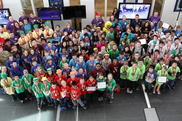 Students and Team Aberdeen Proving Ground volunteers get together for a group picture after the For Inspiration and Recognition of Science and Technology Lego League Qualifier held at ATEC headquarters Jan. 20, 2018.