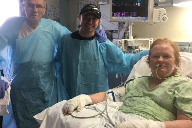 Staff Sgt. Nicholas Davis, C Battery, 1st Battalion, 320th Field Artillery Regiment, 101st Airborne Division (Air Assault) artillery cannon crew member and section chief, visits Rick and Sharon Steiert in the hospital, June 17, 2017, as they recover from a car accident that occurred June 9, 2017. Davis selflessly put himself in harm's way to rescue them from a burning vehicle and was subsequently awarded the Soldier's Medal during a Fort Campbell ceremony, Jan. 22, 2018.