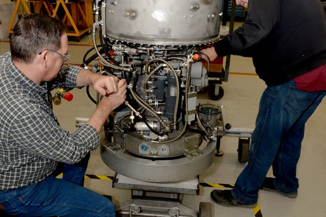 Engine mechanics Thomas Sutherland and Christopher Hernandez complete assembling on Corpus Christi Army Depot's 1,000th T55 engine, Jan. 5, 2018. It takes two of these Honeywell engines to power the US Army's CH-47 Chinook.